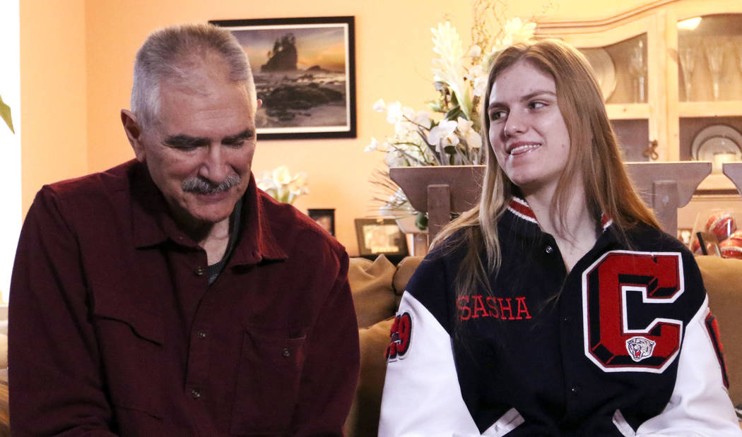 Sasha Bolla, daughter or former UNLV basketball coach Jim Bolla, left, smiles as she and her father are interviewed in their home in Las Vegas, Thursday, Feb. 7, 2019. (Heidi Fang/Las Vegas Review ...