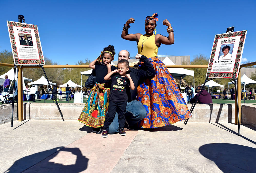 Rahsheda Ness, right, poses with her family from left, Isabelle, 5, Gavin, 3 and her husband Steven during the Black History Month Festival at the Springs Preserve Saturday, Feb. 16, 2019, in Las ...