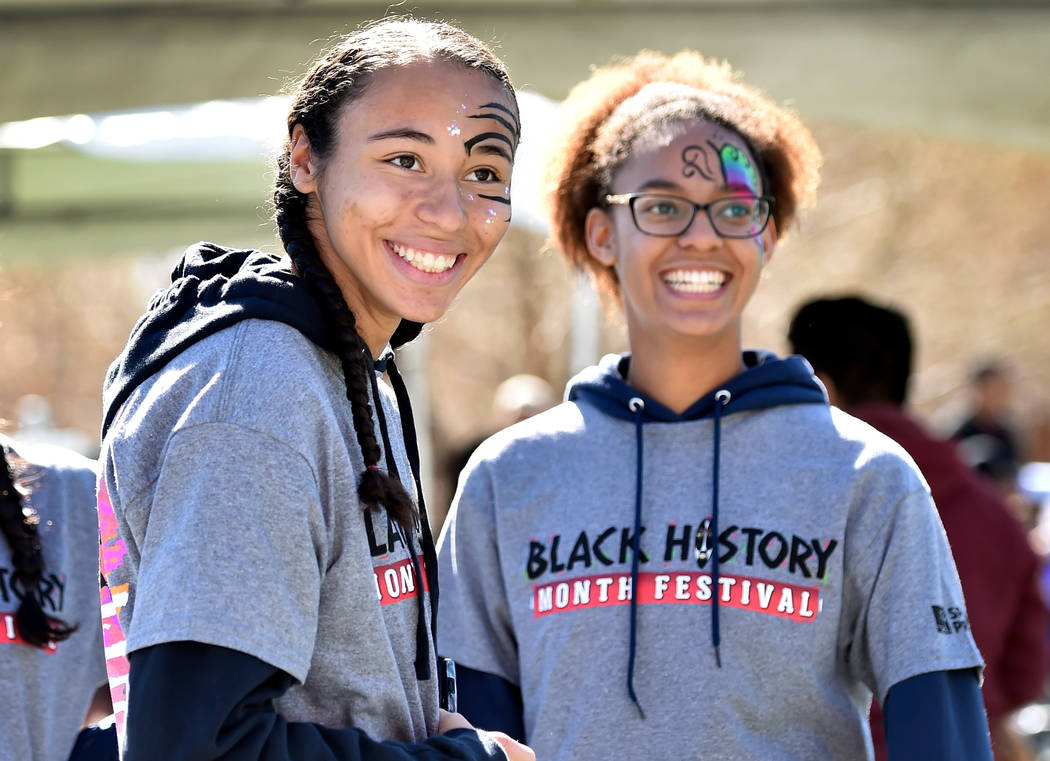 Volunteers Kennedy Enus, left, and Zia Makhathini watch a performance during the Black History Month Festival at the Springs Preserve Saturday, Feb. 16, 2019, in Las Vegas. The 10th annual event c ...