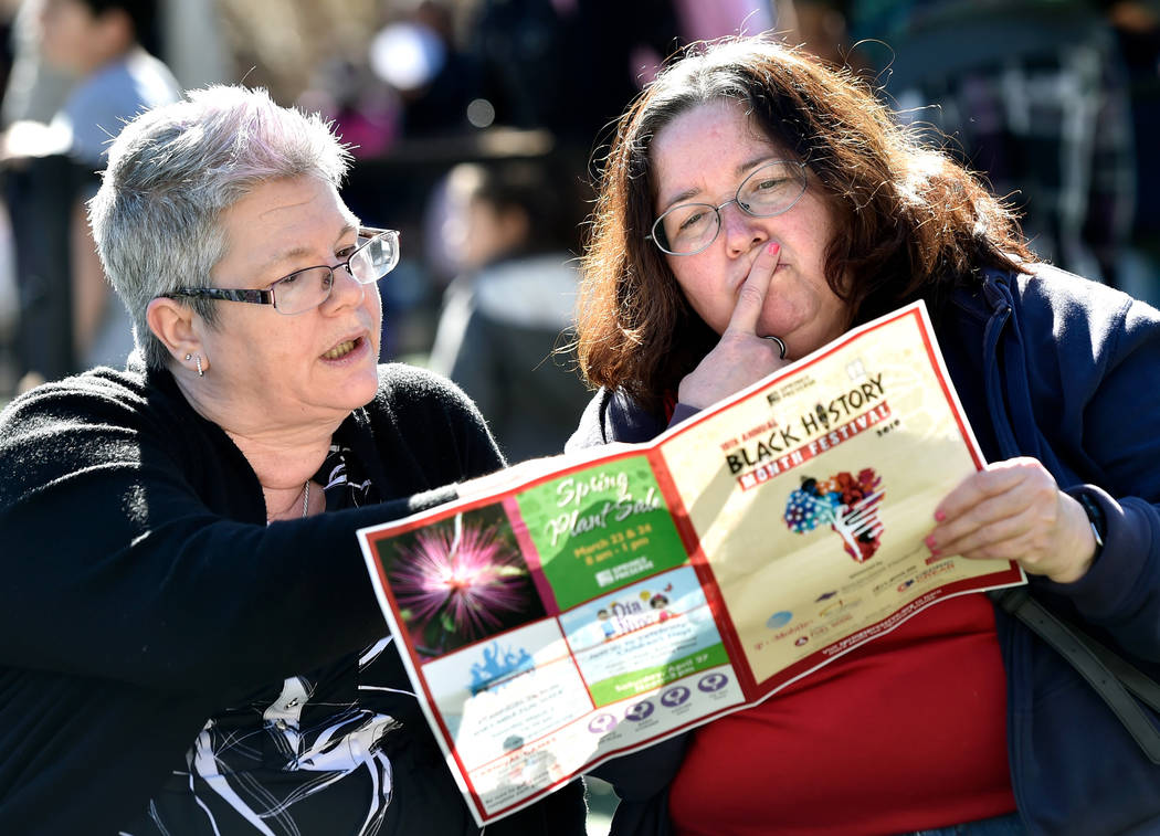 Marsha Rodenbeck, left, and Gina Slover review the event's program during the Black History Month Festival at the Springs Preserve Saturday, Feb. 16, 2019, in Las Vegas. The 10th annual event cele ...