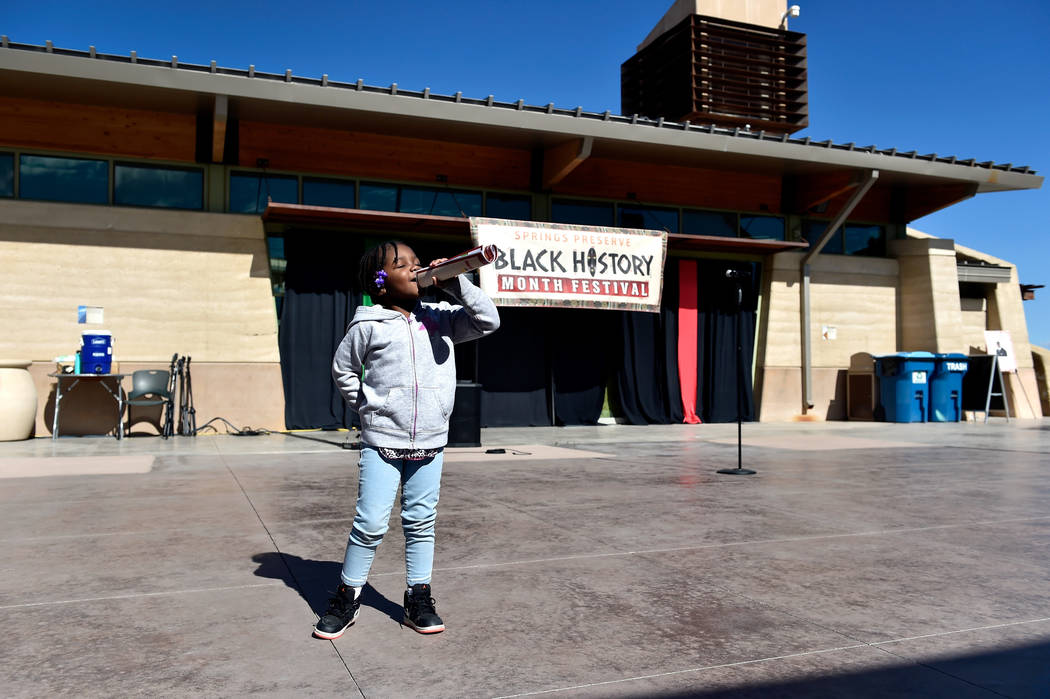 Janiyah Payne, 4, pretends to sing on stage during the Black History Month Festival at the Springs Preserve Saturday, Feb. 16, 2019, in Las Vegas. The 10th annual event celebrated the contribution ...
