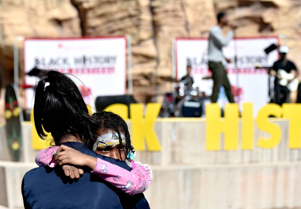 Israel Knight, 5, holds on to her mother, Victoria Knight during a performance at the Black History Month Festival at the Springs Preserve Saturday, Feb. 16, 2019, in Las Vegas. The 10th annual ev ...