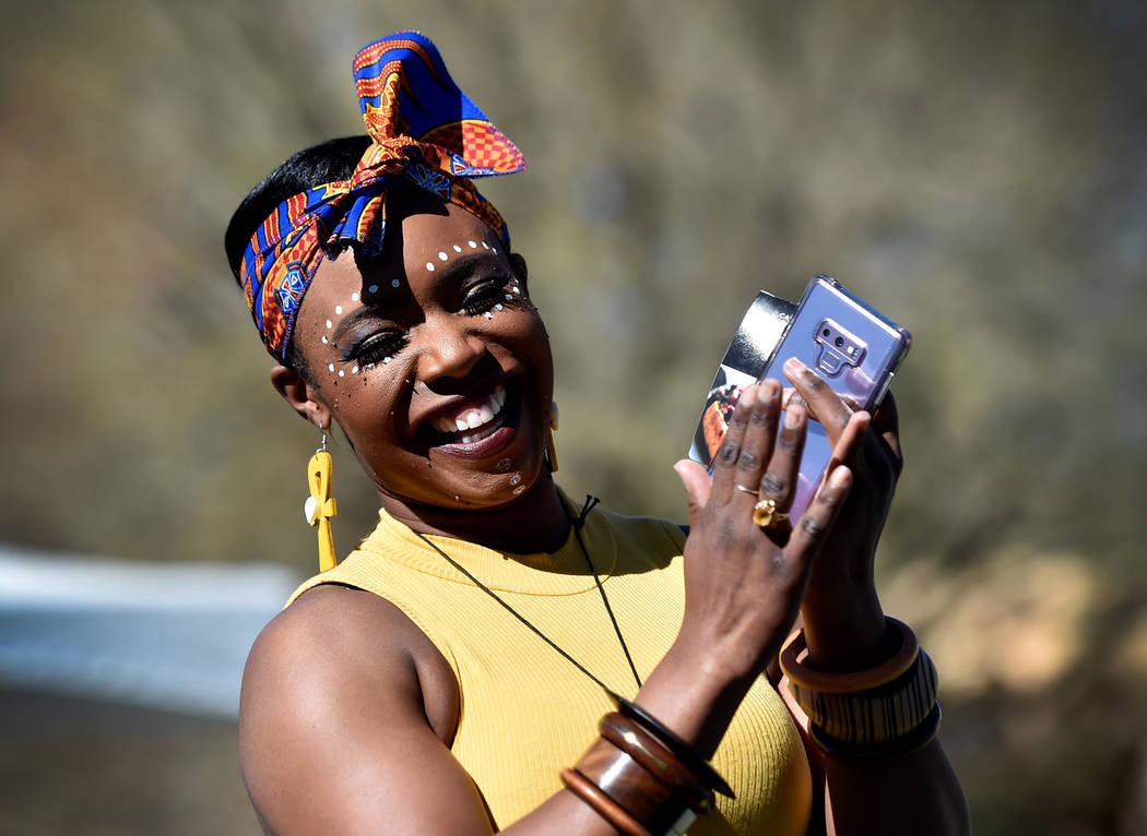 Rahsheda Ness applauds her children while they play a carnival game during the Black History Month Festival at the Springs Preserve Saturday, Feb. 16, 2019, in Las Vegas. The 10th annual event cel ...