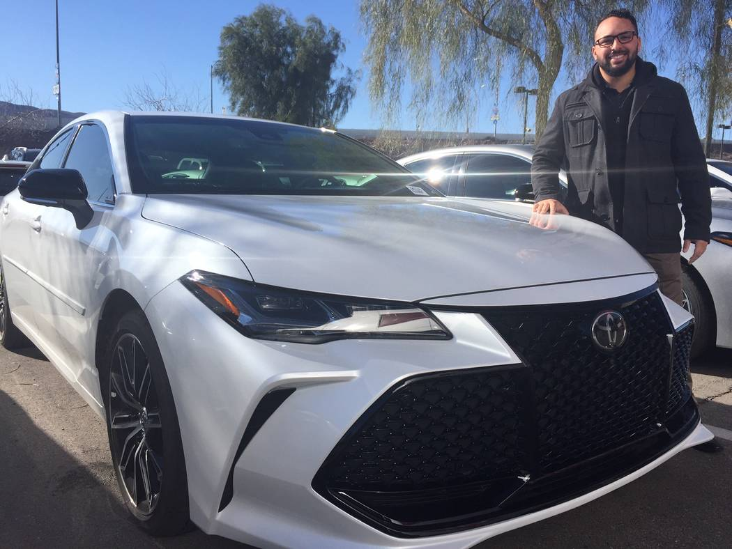 Findlay Toyota veteran sales consultant John Estrella shows off the newly redesigned 2019 Avalon at the dealership situated at 7733 Eastgate Road in the Valley Automall. (Findlay)