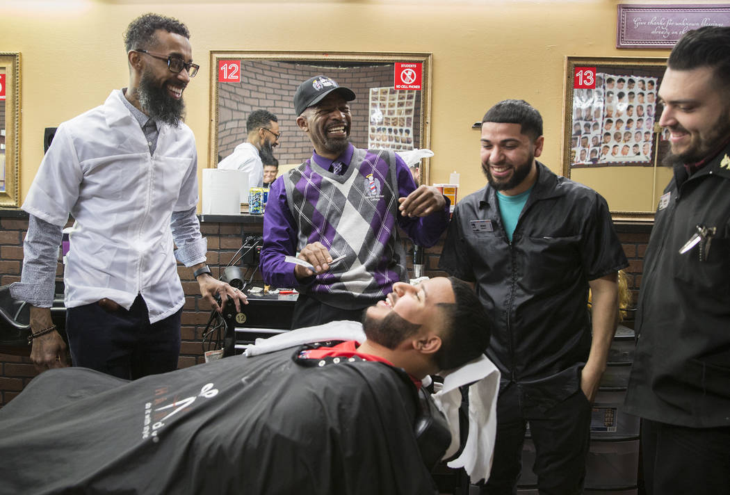 Royal Byron, second from right, shares a moment with his students at Nevada's First Barber School on Friday, Feb. 8, 2019, in Las Vegas. (Benjamin Hager/Las Vegas Review-Journal) @BenjaminHphoto