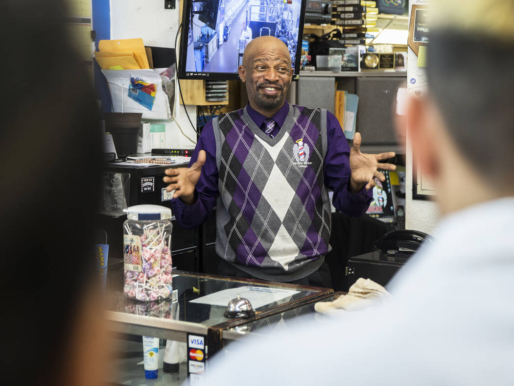 Royal Byron, founder and owner of Nevada's First Barber School, talks with his students before the doors open on Friday, Feb. 8, 2019, in Las Vegas. (Benjamin Hager/Las Vegas Review-Journal) @Benj ...
