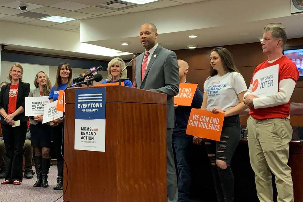 Nevada Attorney General Aaron Ford stands with supporters on Tuesday, Feb. 12, 2019, as he announces a lawsuit filed with the Nevada Supreme Court for an extension&#x ...