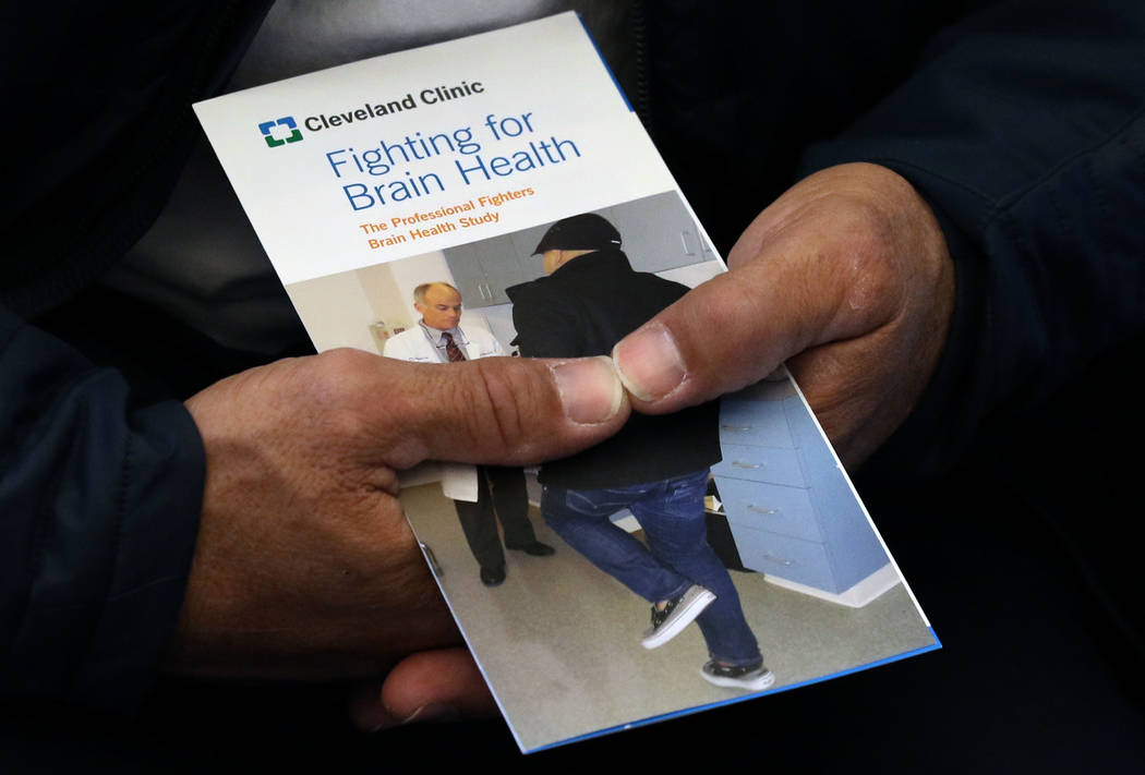 Professional bull rider Aaron Semas of Weatherford, Texas, holds Fighting for Brain Health brochure as he speaks during an interview with the Las Vegas Review-Journal at Cleveland Clinic on Tuesda ...
