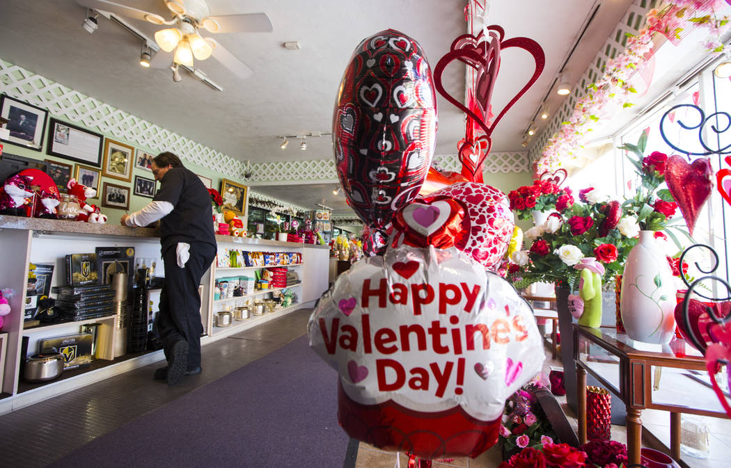 Blake, left, who declined to give his last name, makes an order for Valentine's Day at DiBella Flowers & Gifts in Las Vegas on Tuesday, Feb. 12, 2019. (Chase Stevens/Las Vegas Review-Journal) ...