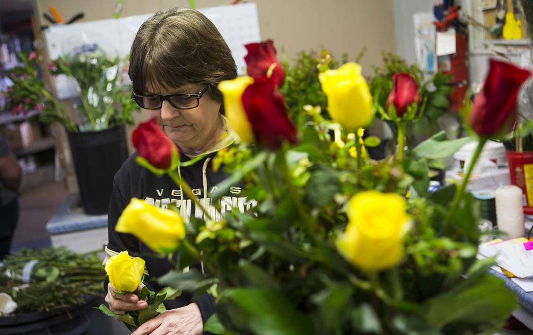 Susan DiBella arranges roses in a bouquet ahead of Valentine's Day at DiBella Flowers & Gifts in Las Vegas on Tuesday, Feb. 12, 2019. (Chase Stevens/Las Vegas Review-Journal) @csstevensphoto