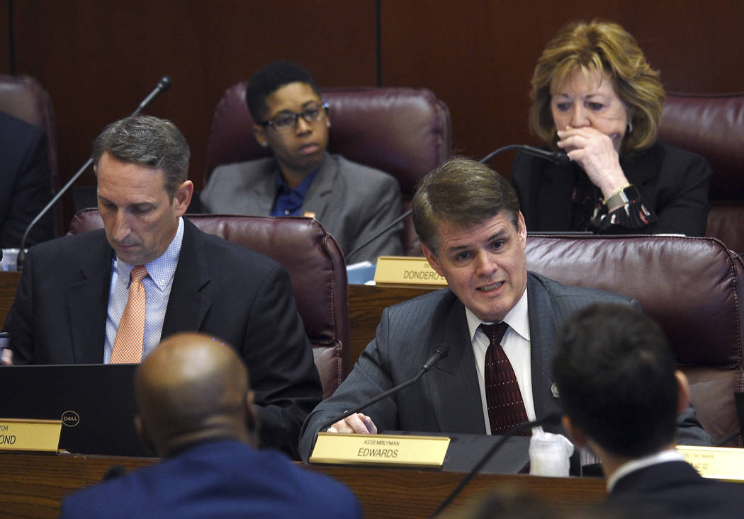 Republican Assemblyman Chris Edwards asks a question of state Senate Majority Leader Kelvin Atkinson and William Rosen, with Everytown for Gun Safety, during a hearing for Senate Bill 143 at the N ...