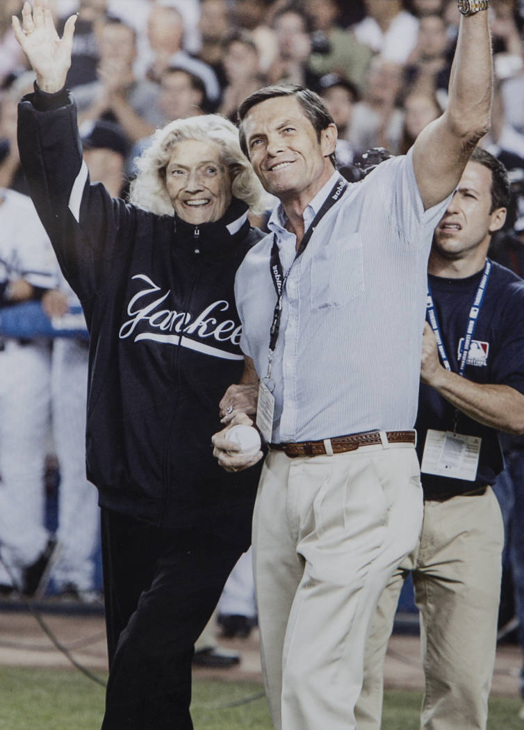 A photo of Julia Ruth Stevens, left, the daughter of New York Yankee Hall of Fame slugger Babe Ruth, and son Tom Stevens waving to fans before Ruth Stevens threw out the first pitch at the last ga ...