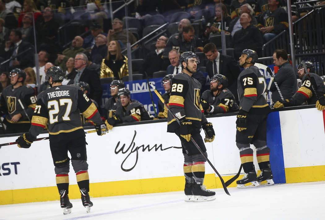 Golden Knights left wing William Carrier (28) and right wing Ryan Reaves (75) react after giving up a goal to the Arizona Coyotes during the second period of an NHL hockey game at T-Mobile Arena i ...