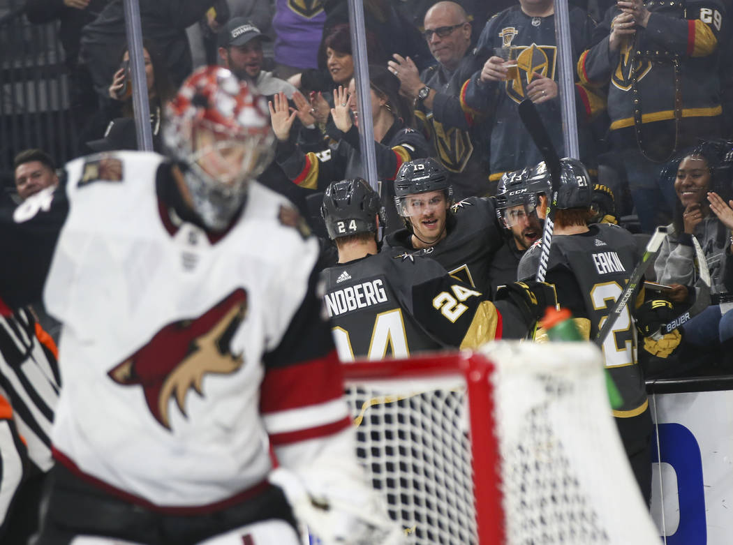 Golden Knights players celebrate a goal by center Brandon Pirri, third from left, during the second period of an NHL hockey game against the Arizona Coyotes at T-Mobile Arena in Las Vegas on Tuesd ...