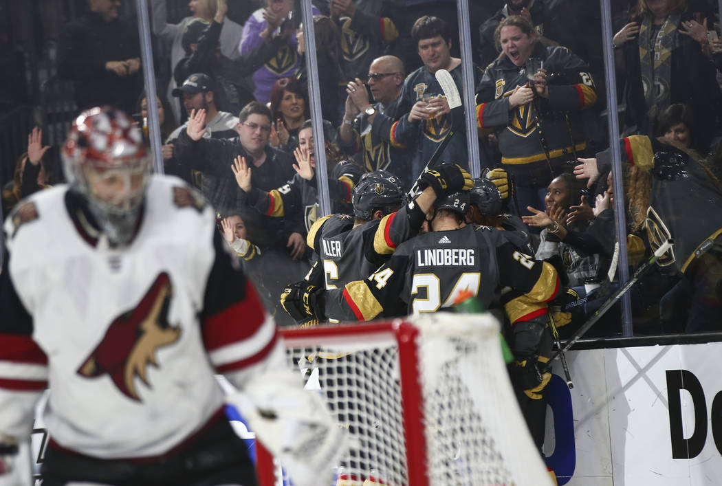 Golden Knights players celebrate a goal by center Brandon Pirri during the second period of an NHL hockey game against the Arizona Coyotes at T-Mobile Arena in Las Vegas on Tuesday, Feb. 12, 2019. ...