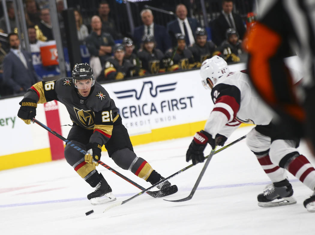 Golden Knights center Paul Stastny (26) moves the puck past Arizona Coyotes defenseman Jordan Oesterle (82) during the first period of an NHL hockey game at T-Mobile Arena in Las Vegas on Tuesday, ...