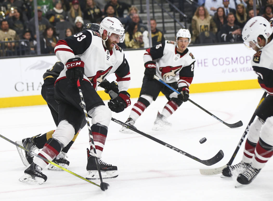 Arizona Coyotes defenseman Alex Goligoski (33) moves the puck against the Golden Knights during the first period of an NHL hockey game at T-Mobile Arena in Las Vegas on Tuesday, Feb. 12, 2019. (Ch ...