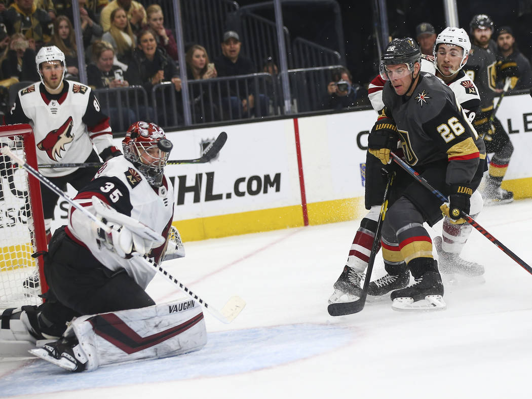 Golden Knights center Paul Stastny (26) attempts a shot against Arizona Coyotes goaltender Darcy Kuemper (35) during the first period of an NHL hockey game at T-Mobile Arena in Las Vegas on Tuesda ...