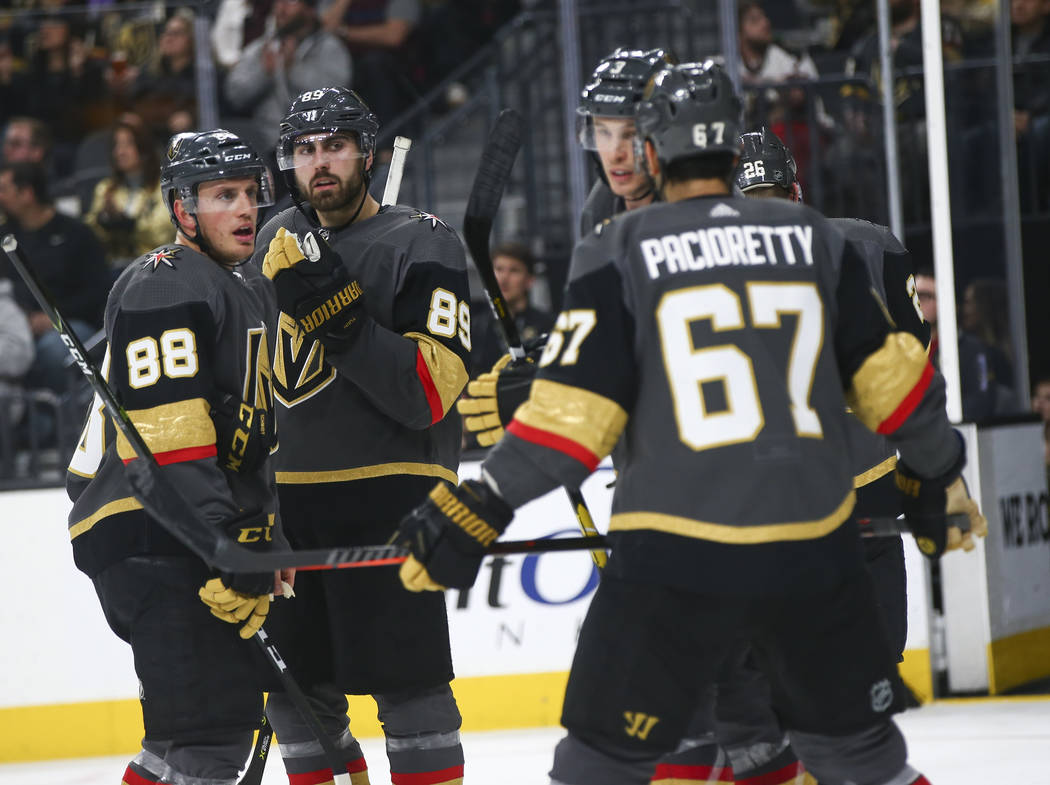 Golden Knights defenseman Nate Schmidt (88) and right wing Alex Tuch (89) react after getting scored on during the third period of an NHL hockey game at T-Mobile Arena in Las Vegas on Tuesday, Feb ...