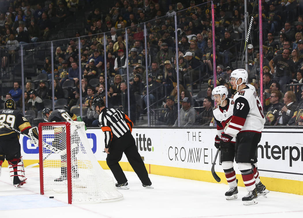 Arizona Coyotes right wing Josh Archibald, left, and left wing Lawson Crouse (67) celebrate a goal against the Golden Knights during the third period of an NHL hockey game at T-Mobile Arena in Las ...