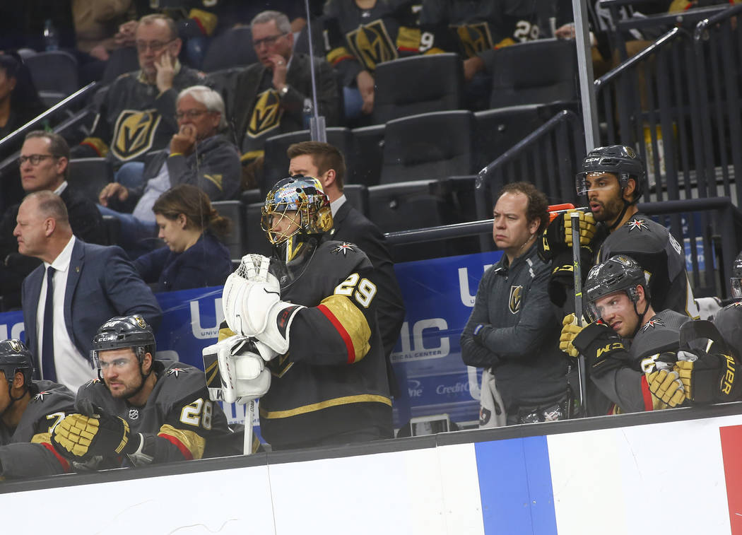 Golden Knights goaltender Marc-Andre Fleury (29) looks on after getting benched in the final minutes of the third period of an NHL hockey game against the Arizona Coyotes at T-Mobile Arena in Las ...