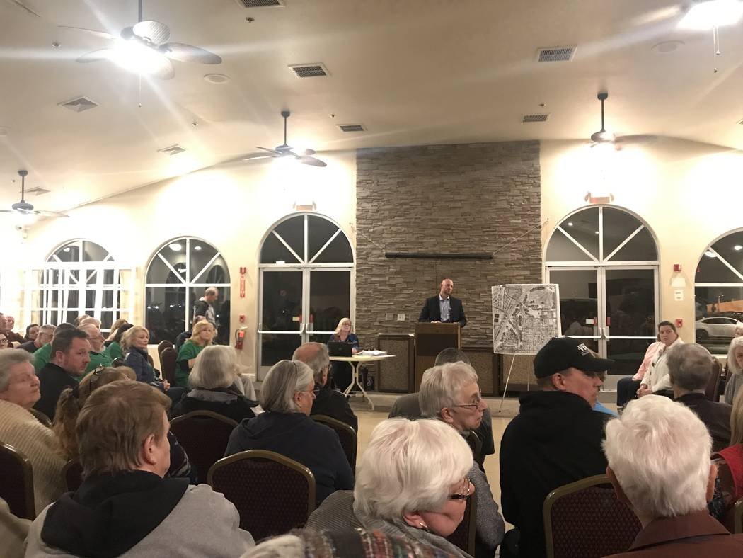 Michael Tassi, community development and services department director for the City of Henderson, takes questions at the neighborhood meeting at Black Mountain Golf Course and Country Club on Monda ...