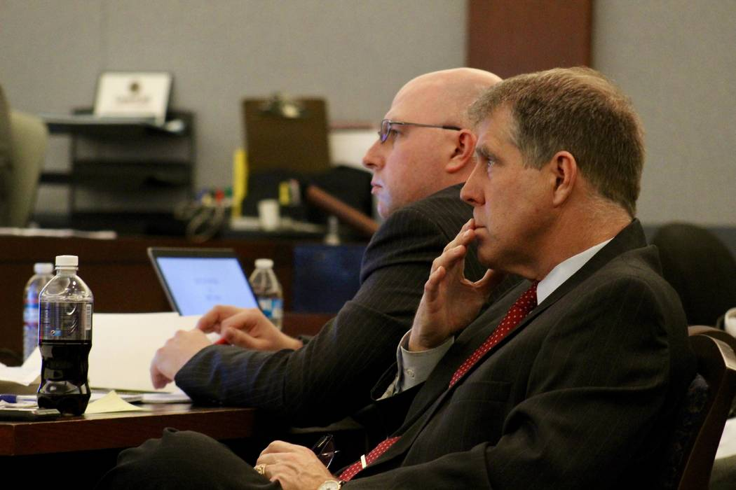 Craig Mueller (front) and Metropolitan Police Department officer Bret Theil (back) listen to closing arguments on Tuesday, February 12, 2019 at the Regional Justice Center. Theil is accused of sex ...