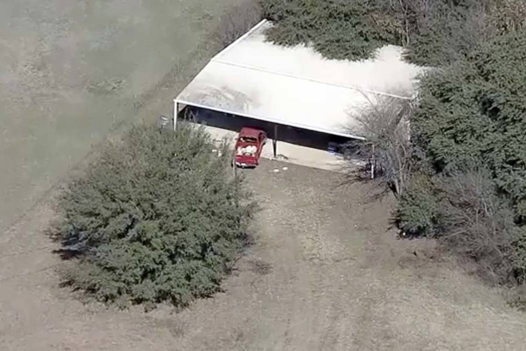 This aerial image provided shows part of the property where deputies found two young, malnourished children locked together in a dog cage near Rhome, Texas about 20 miles northwest of Fort Worth.T ...