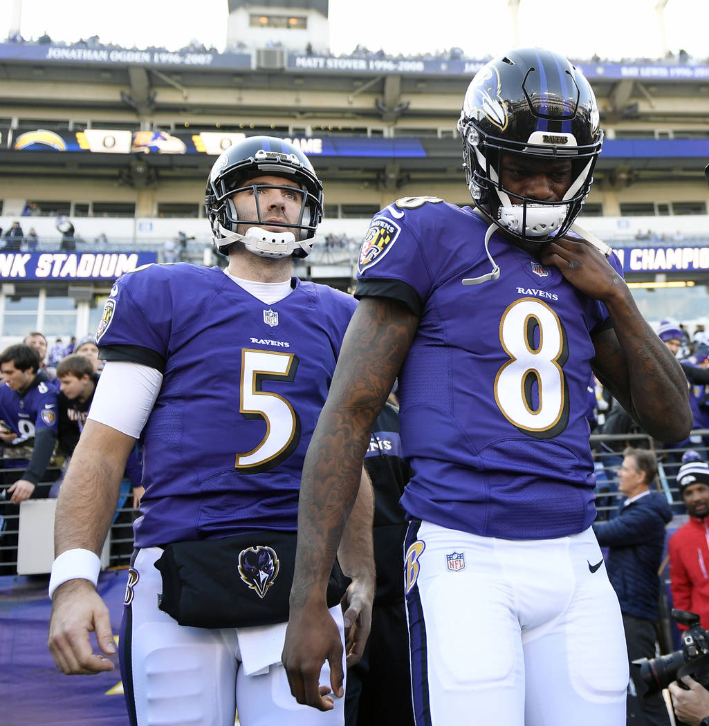 In this Jan. 6, 2019, file photo, Baltimore Ravens quarterbacks Lamar Jackson (8) and Joe Flacco walk onto the field before an NFL wild card playoff football game against the Los Angeles Chargers, ...