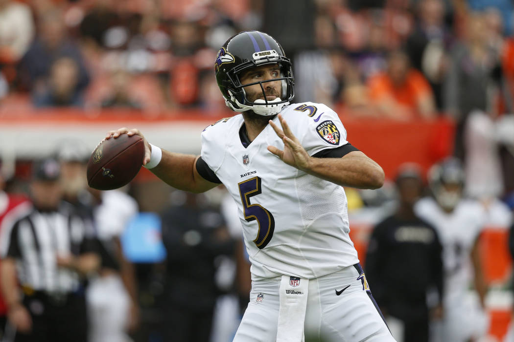 In this Oct. 7, 2018, file photo, Baltimore Ravens quarterback Joe Flacco throws during the first half of an NFL football game against the Cleveland Browns, in Cleveland. (AP Photo/Ron Schwane, File)