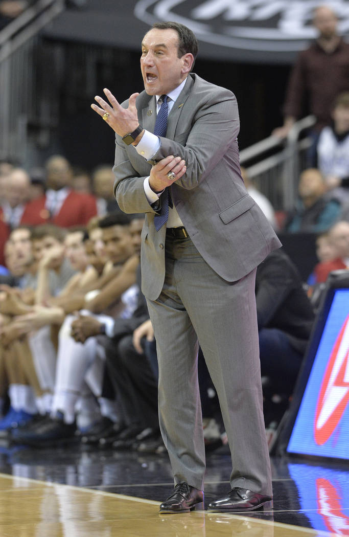 Duke head coach Mike Krzyzewski argues a call during the second half of the team's NCAA college basketball game against Louisville in Louisville, Ky., Tuesday, Feb. 12, 2019. Duke won 71-69. (AP P ...