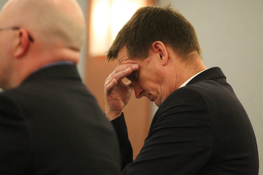 Patrick Hardy, a defense private investigator, reacts after Bret Theil was found guilty of 28 counts, including kidnapping, lewdness with a child under 14, and sexual assault, at the Regional Just ...