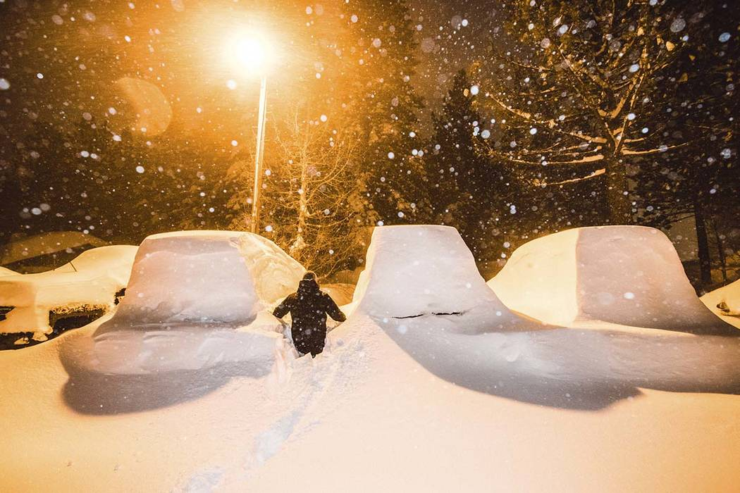 A winter storm buried vehicles in Mammoth Mountain, Calif., early Sunday Feb. 3, 2019. Forecasters said a blizzard with high winds is heading toward the Lake Tahoe area, where another 2 feet of s ...