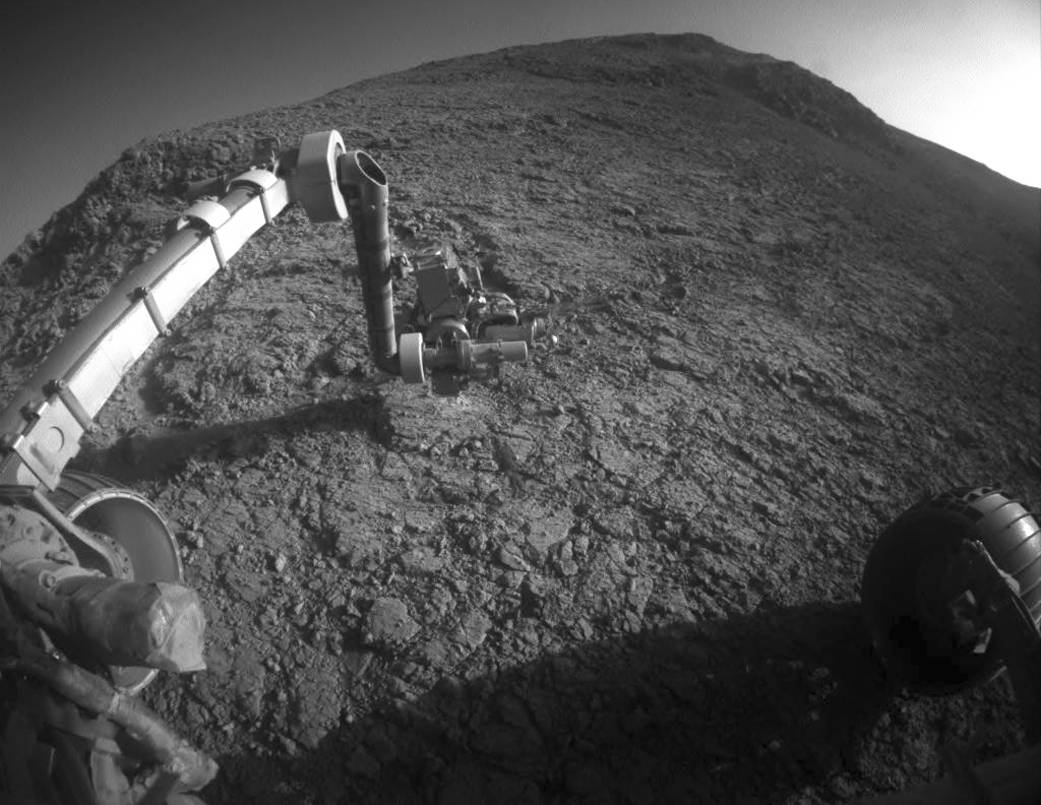 """The tool turret at the end of the the Opportunity rover's robotic arm on the southern side of """"Marathon Valley,"""" which goes through the western rim of Endeavour Crater. (NASA/JPL-Caltech via AP)"""