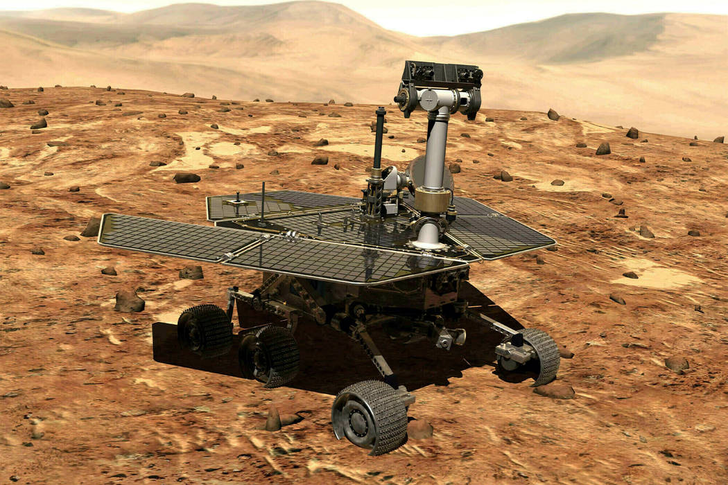 This illustration made available by NASA shows the rover Opportunity on the surface of Mars. The exploratory vehicle landed on Jan. 24, 2004, and logged more than 28 miles (45 kilometers) before f ...