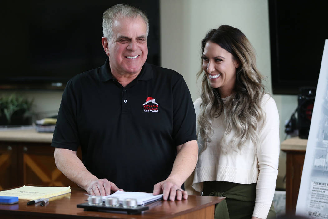 Arnold Stalk, left, president of Veterans Village, with Nicole Christie, during a ribbon cutting ceremony for Christie's new business T.H.E. Salon, at the Veterans Village in Las Vegas, Wednesday, ...
