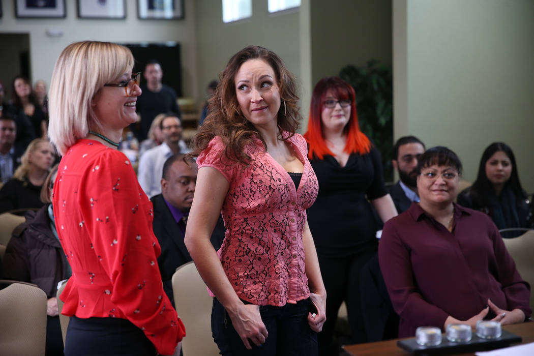 Sarah Hays, from left, Misty Sumner, and Amy Lasagna, employees for T.H.E. Salon, are recognized during a ribbon cutting ceremony at the Veterans Village in Las Vegas, Wednesday, Feb. 13, 2019. (E ...