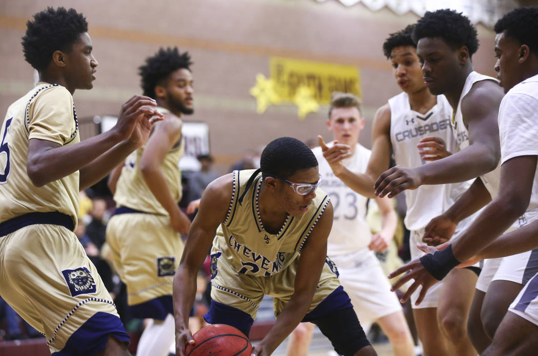 Cheyenne's Davey Burdette (20) looks to move the ball during the first half of a basketball game at Faith Lutheran High School in Las Vegas on Wednesday, Feb. 13, 2019. (Chase Stevens/Las Vegas Re ...