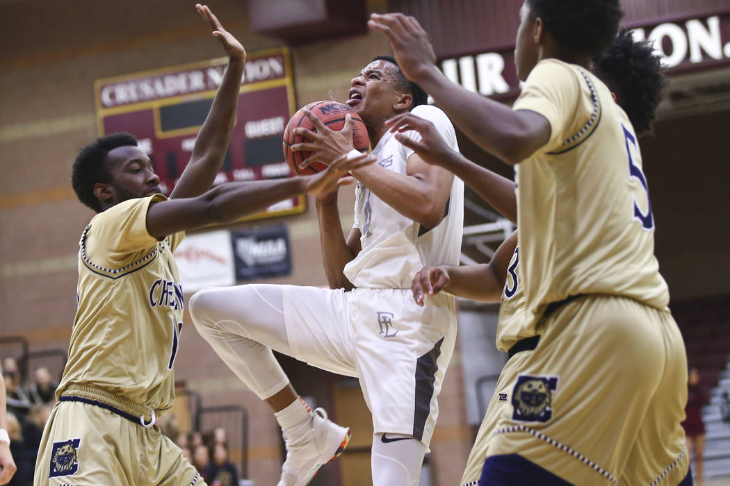 Faith Lutheran's Sedrick Hammond (4) goes to the basket against Cheyenne's De'Kquante Hayes, left, during the first half of a basketball game at Faith Lutheran High School in Las Vegas on Wednesda ...