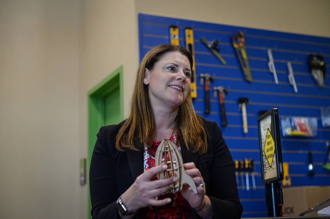CEO Melissa Kaiser holds a rocket ship made from wood cut in a laser cutter available in the new Discovery Lab at the Discovery Children's Museum in Las Vegas, Tuesday, Feb. 12, 2019. Caroline Bre ...
