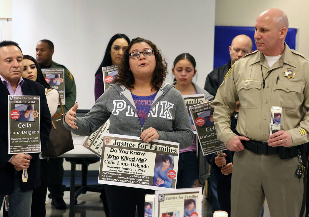 Sheyla Padilla, center, daughter of Celia Luna-Delgado, a homicide victim from last January, speaks, Thursday, Feb. 14, 2019, in Las Vegas, as Lt. Hector Cintron of Metropolitan Police Department, ...