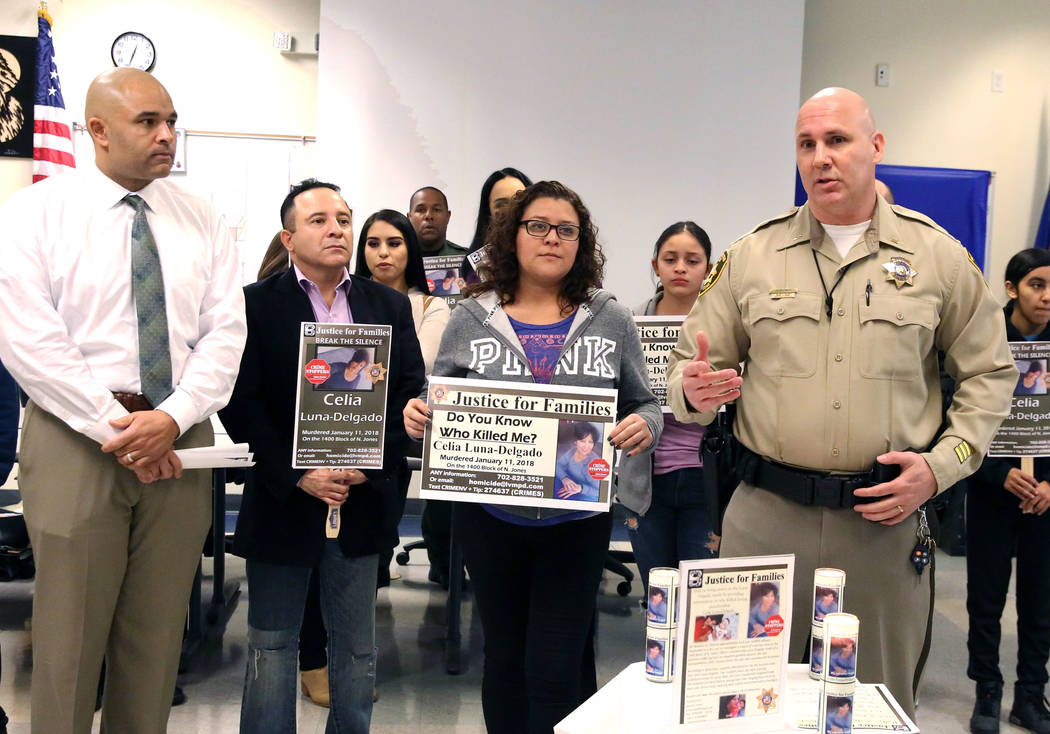 Metropolitan Police Department Lt. Hector Cintron, right, speaks, Thursday, Feb. 14, 2019, in Las Vegas, as Sheyla Padilla, second from right, daughter of Celia Luna-Delgado, a homicide victim fro ...