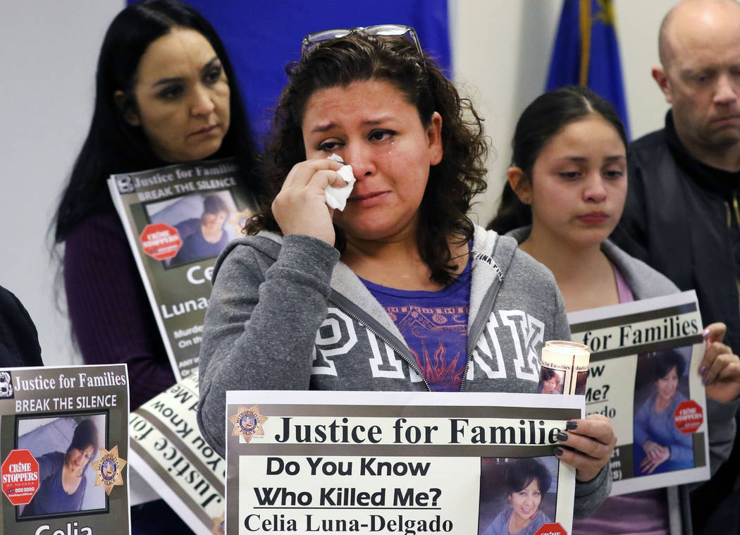 Sheyla Padilla, daughter of Celia Luna-Delgado, a homicide victim from last January, wipes a tear as Metropolitan Police Department Homicide Lt. Ray Spencer, not photographed, speaks, Thursday, Fe ...