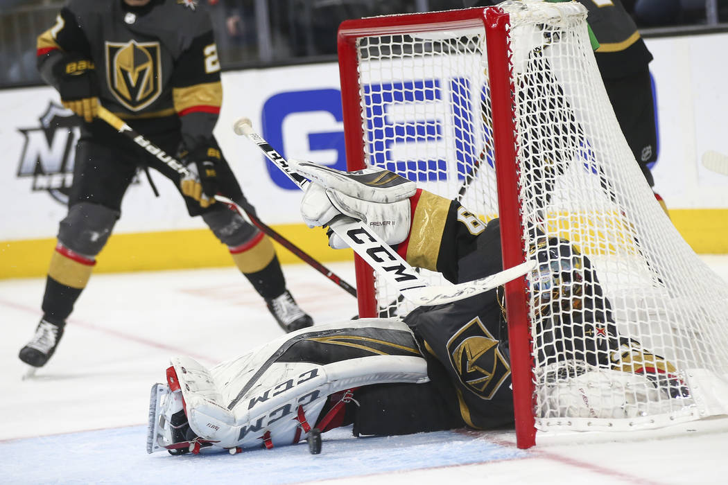 Golden Knights goaltender Marc-Andre Fleury (29) falls into the net while giving up a goal to the Arizona Coyotes during the third period of an NHL hockey game at T-Mobile Arena in Las Vegas on Tu ...