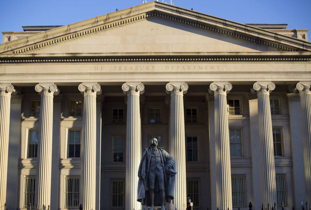 This June 8, 2017, file photo shows the U.S. Treasury Department building in Washington. The national debt has passed a new milestone, topping $22 trillion for the first time. (AP Photo/Pablo Mar ...