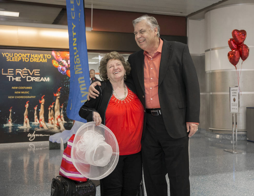 TC Shade, left, from Phoenix, Ariz., and husband Jay celebrate after getting their marriage license at a Clark County pop-up office in the baggage claim area at Terminal 1 on Wednesday, Feb. 13, 2 ...