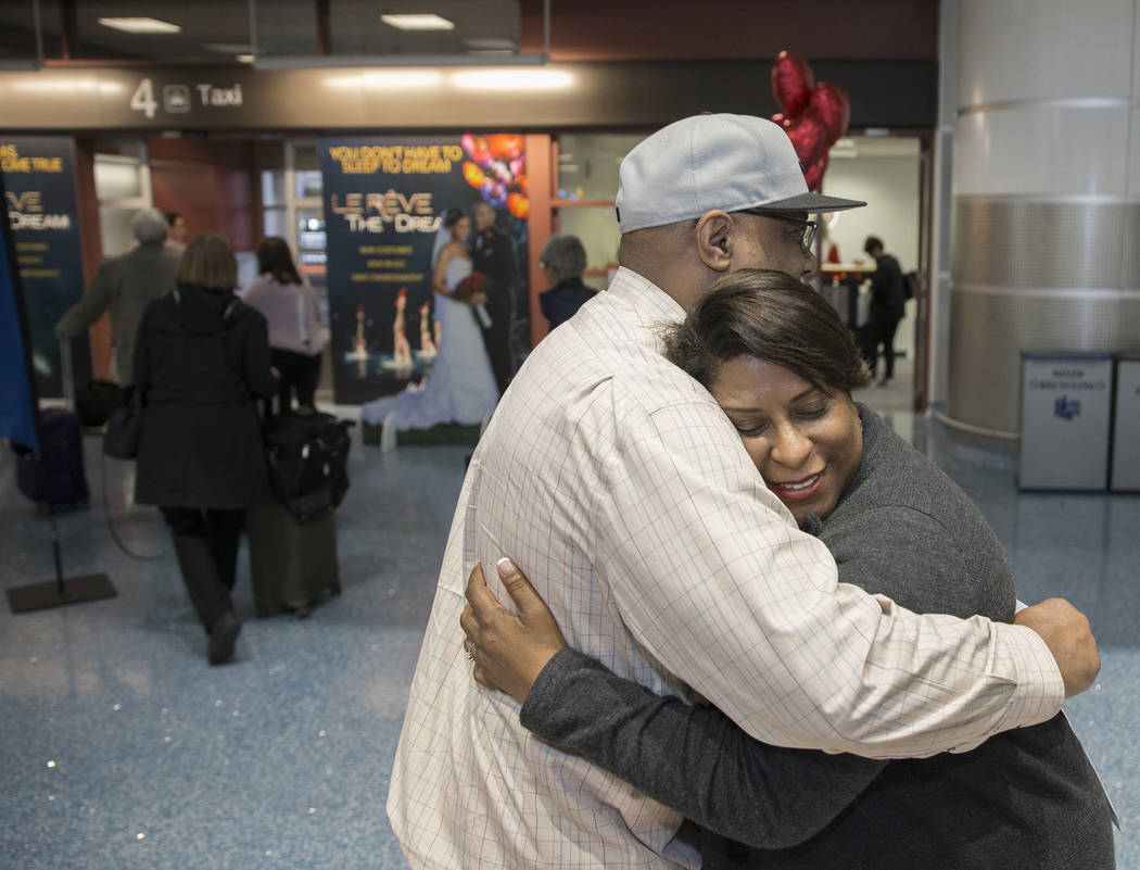 Tandra Jones, right, from Charleston, S.C., hugs husband Dennis after getting their marriage license at a Clark County pop-up office in the baggage claim area at Terminal 1 on Wednesday, Feb. 13, ...
