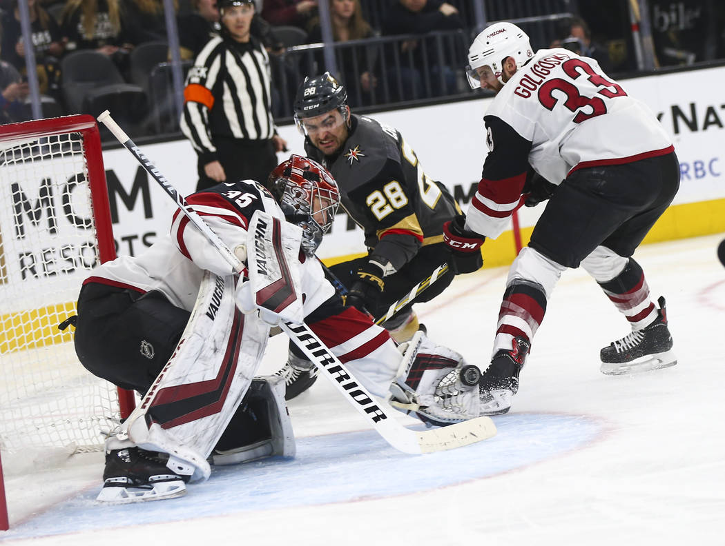 Arizona Coyotes goaltender Darcy Kuemper (35) blocks a shot from Golden Knights left wing William Carrier (28) during the first period of an NHL hockey game at T-Mobile Arena in Las Vegas on Tuesd ...