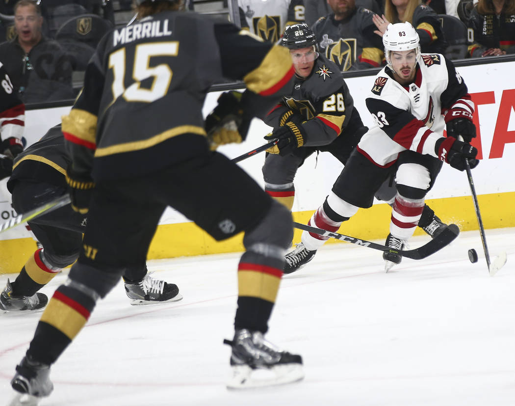 Arizona Coyotes right wing Conor Garland (83) moves the puck past Golden Knights center Paul Stastny (26) during the third period of an NHL hockey game at T-Mobile Arena in Las Vegas on Tuesday, F ...