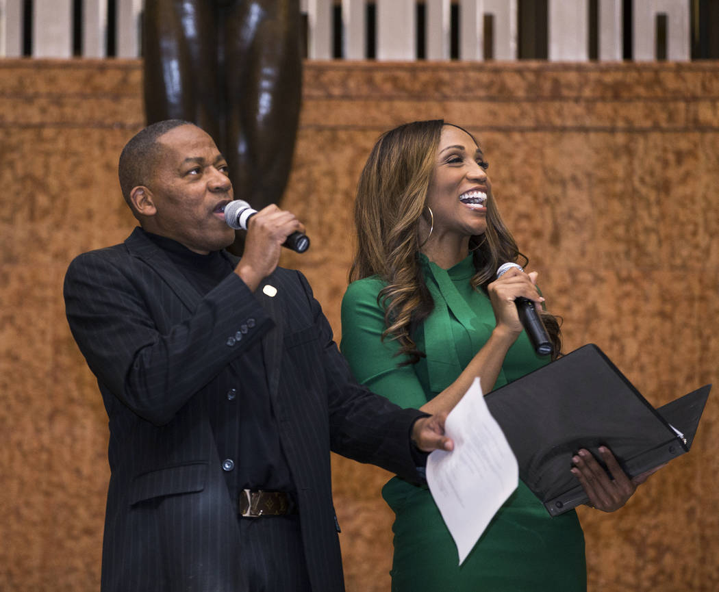 Commissioner Lawrence Weekly, left, and Krystal Allen share a laugh with the audience during an event in coordination with Black History Month on Wednesday, Feb. 13, 2019, at The Smith Center, in ...
